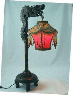 Dragon lamp. Oooh, I likey reminds me of that one I bought when we went on that major antique trip, and I ended up with a floor one like this except had gold color glass instead, I still miss that baby.