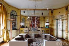 Those artful walls are not the only element that has remained intact. The master bath still flaunts its original black-and-white marble mosaics, and the living room retains the elegant ornamental columns and wall paneling installed in the 1950s by the legendary French decorating firm Maison Jansen. In a sitting room of the Paris apartment that ELLE DECORATION France editor Sylvie de Chirée shares with her husband, furniture dealer Philippe Rapin, a circa-1970 Marc Cavell mobile hangs above…