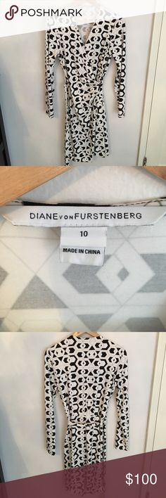 """Iconic Diane Von Furstenberg Valencia wrap dress Perfect classic DVF wrap dress.  Valencia hex maze print. 100% authentic. Shoulder to hem is 40"""". Size 10. I'm usually a 6-8 and it fits well.  Wonderful condition, maybe worn 3 times. Diane von Furstenberg Dresses"""