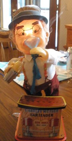 """Charley Weaver Bartender Toy. A toy from the 1970s. After he """"drinks"""" from the cup, his face lights up and smoke comes out of his ears."""