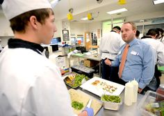 T.J. Strasser, right, talks with Caleb Strong, left, during #ProStart at Broomfield High School in Broomfield, Colorado March 14, 2014. Boulder Daily Camera/ Mark Leffingwell