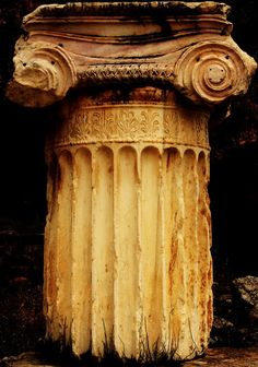Archaeological Site of Delphi. Ionic rhythm column fragment located along the Sacred Way near the Stoa of the Athenians