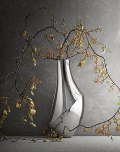 FLORA–a polished stainless steel vase with sculptural contours. Starting with a form that is a loose interpretation of the female body, contemporary designer Todd Bracher plays with contrasts in his FLORA collection. The vase mixes curves with slenderness: a contrast often found in nature. The shape is unexpected rather than symmetrical; its asymmetry is also a feature borrowed from nature. Click to see more from Georg Jensen! #vase #georgjensen #scandinaviandesign #nordicliving