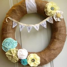 Spring Pennant Banner Burlap Wreath with Pastel Yellow, Teal, White Fabric and Lace Flowers. $33.00, via Etsy.