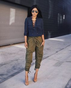 Jenny Bernheim is wearing a gorgeous navy lace up blouse here, paired with khaki combat pants and nude heels. This look is stylish and sophisticated, perfect for work or leisure. Top: H&M, Trousers: Cargo, Shoes: Primpy by Steve Madden.