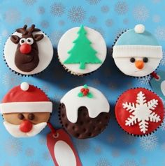 Six cupcakes decorated with different christmas designs