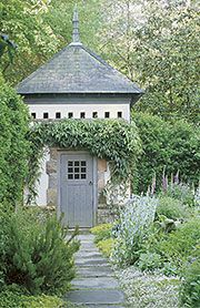 Garden Shed..... omg, this setting is gorgeous. Just noticed the round holes at the top, a birdhouse?