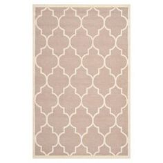 "Add a pop of pattern to your living room or den with this hand-tufted wool rug, showcasing a quatrefoil motif in beige and ivory.   Product: RugConstruction Material: WoolColor: Beige and ivoryFeatures:  Hand-tuftedMade in India Pile Height: 0.63""Note: Please be aware that actual colors may vary from those shown on your screen. Accent rugs may also not show the entire pattern that the corresponding area rugs have.Cleaning and Care: Professional cleaning recommended"