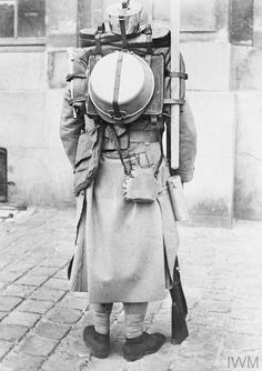 WWI, July 1917, Vincennes; A French soldier displaying the soldier's full equipment load. ©IWM Q 50382