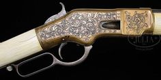 peashooter85:  An engraved, ivory stocked Winchester Model...