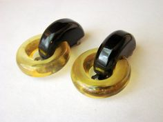 JoysShop is pleased to submit for consideration this rare and unique pair of art deco vintage dress or fur clips, featuring a combination of apple juice Bakelite (tested) a... #teamlove #voguet #vjse2