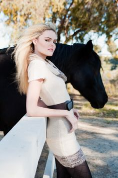 But with the horse's head kicked back to her (almost hugging her neck)