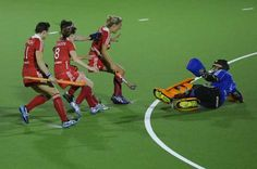 England's goalkeeper Maddie Hinch (R) and her teammates celebrate after winning a semi-final field hockey match between the Netherlands and England during the European Hockey Championships 2013 on August 22, 2013 at the Braxgata hockey club in Boom