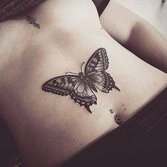 Butterfly tattoo on the stomach. Tattoo artist: Alex Bawn