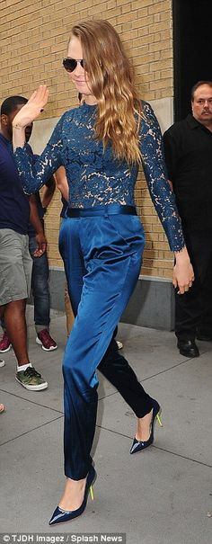 Making waves: Cara gave her Big Apple fans a wave as she left the building to head to her ...