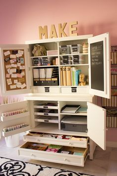 Organize your scrapbooking or craft room using Martha Stewart furniture, or other similar organizational pieces.