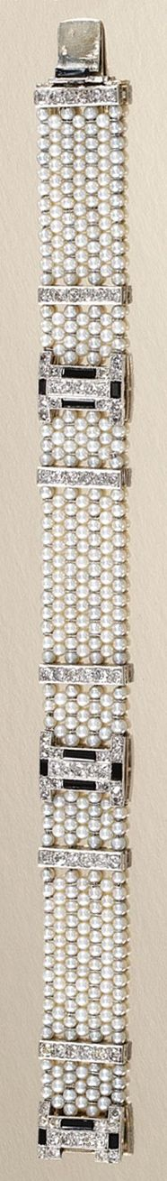 SEED PEARL, ONYX AND DIAMOND BRACELET, CARTIER, 1920S.  Designed as a woven mesh of seed pearls, applied at intervals with baton-shaped links and geometric motifs, millegrain- and channel-set throughout with circular-, single-cut diamonds and polished onyx, length approximately 170mm, signed Cartier Paris, French assay and maker's marks.
