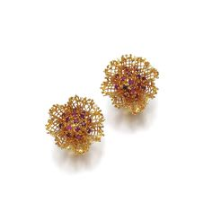 PAIR OF RUBY EAR CLIPS, VAN CLEEF & ARPELS Each of lace design, the centres set with clusters of circular-cut rubies, signed Van Cleef & Arpels, numbered, French assay and maker's marks.