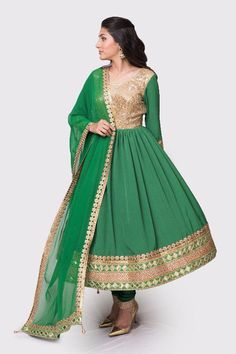 Stand out in this captivating emerald green and gold anarkali, beautifully complemented with a gold-trimmed matching dupatta. #Anarkali #Madeforyou #Emerald