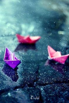 Paper boats in the rain.