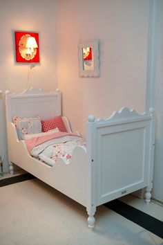 Vintage styly kids bed ( would help stop them from rolling out)