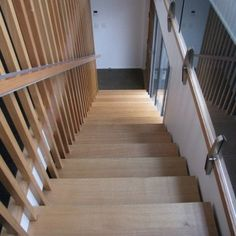Steel stair with Australian oak treads and timber slat balustrade