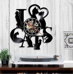 This vintage style wall clock is made from an original vinyl music record with Led component. This creative handmade art is a perfect Christmas, Anniversary, Birthday, Valentines or a wedding gift. We can also custom make any personalized design for you, if you need a custom made design or for bulk orders queries please contact us.  #Valentine #watch #home decoration #decor #home decor #wall art #cat's love #lovers #pet #the love kin #
