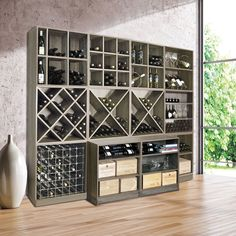 Wooden wine rack system CAVEPRO Wenge decor- Weinregal-System CAVEPRO aus Holz im Dekor Wenge Classic wine rack system with versatile modules, both for cellar, living area or for commercial use in wine shops or restaurants. Wine Rack Storage, Wine Rack Cabinet, Wine Rack Wall, Wine Wall, Wine Rack Shelf, Built In Wine Rack, Rack Tv, Wine Cellar Racks, Home Wine Cellars