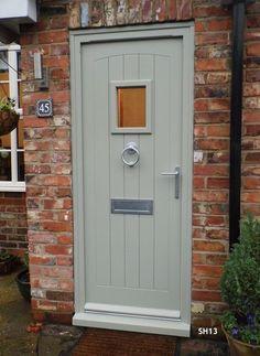 Beautiful grey timber front door, with matching satin chrome door fittings...htm