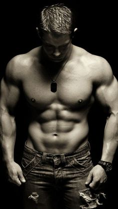 I have no clue who the hell that is bit I how that his face is as hot as his body!! <3