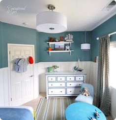This classic boys room is so fresh with its monochromatic colour scheme (but how I wish that light was properly installed into the ceiling! And maybe the drapes should be mounted higher...)