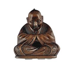 A Wood netsuke of a seated man by Sozan, late 19th/early 20th century | Lot | Sotheby's