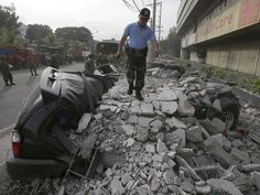 The death toll from a earthquake that struck the central Philippine island of Bohol on Tuesday rose to as rescuers struggled to reach patients in a collapsed hospital. Centuries-old stone churches crumbled and wide areas were without power. Philippines Earthquake, Huge Truck, Cebu City, Bohol, Old Stone, Sounds Like, At Least, Death, Pictures