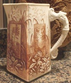 Nancy's Daily Dish: The Aesthetic Movement and Transferware figural pitcher by Ridgway in a pattern called Vistas. It has an unusual, Asian styled dragon handle and is decorated with scenic insets onto the botanical background of bamboo and sunflowers. Aesthetic Movement, Brown Aesthetic, Antique China, Vintage China, Art For Art Sake, Vintage Pottery, Mccoy Pottery, Vintage Dishes, China Patterns