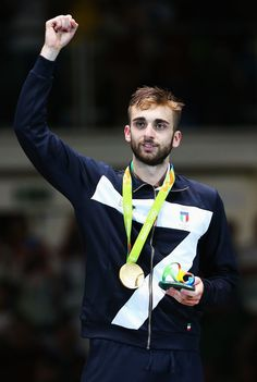 Daniele Garozzo Photos Photos - Gold medalist Daniele Garozzo of Italy celebrates on the podium during the medal ceremony for the Men's Individual Foil Final on Day 2 of the Rio 2016 Olympic Games at Carioca Arena 3 on August 7, 2016 in Rio de Janeiro, Brazil. - Fencing - Olympics: Day 2