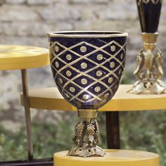 A vase which has nicely designed and its base is crafted uniquely. It's alluring and precious also.