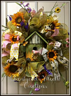 Deco mesh and burlap wreath with sunflowers, birdhouse, bird, butterfly and flowers.  Twentycoats Wreath Creations(2016)