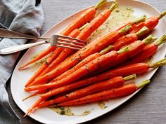 Steamed Carrots with Lemon-Dill Vinaigrette : These are knife-and-fork carrots for your next gathering. Steaming them whole retains their carroty essence; tossing them with lemon-dill vinaigrette while they are still warm allows them to absorb lots of flavor.