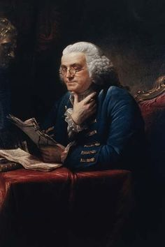Benjamin Franklin, half-length portrait, seated at table, facing left, reading documents.