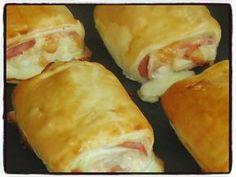 Petits pains jambon mozzarella Temps de préparation : 15 minutesTemps de cuisson : 20 minutesRecette pour 4 petits pains Ingrédients : * 1 pâte feuilletée* 3 tranches de jambon* 2 càs de crème fraîche* 100g de mozzarella* 1 jaune d'œuf pour la dorure...