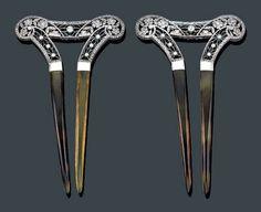 https://www.barnebys.co.uk/realisedprices/lot/5896099/a-pair-of-belle-epoque-18k-white-gold-diamond-and-tortoise-shell-hair-combs/