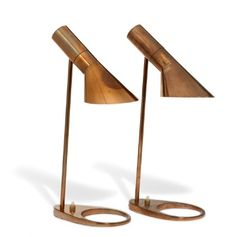 """Arne Jacobsen """"AJ"""". A rare pair of small table lamps of copper/copper-plated metal. Base with switch. Designed 1957. These examples manufactured approx. 1960s by Louis Poulsen. H. 44 cm. (2) Model designed for the SAS Royal Hotel, Copenhagen."""