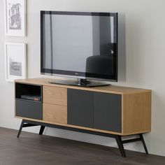 Modern TV cabinet in a stunning fusion of complimentary colours. Features 3 doors, 1 drawer and open storage space and is available in 2 colour combinations. The cabinet is supported by sleek slanted black metal legs.