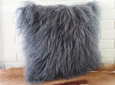 The ultimate fur pillow made of the softest fur in a beautiful pure white. Handmade in our workshop from highest quality Tibetan curly lamb fur.