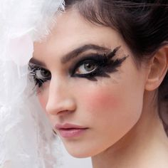 Spring Couture 2013: The dramatic makeup for the Spring Couture 2013 collection focused on black smoky eyes drawn in a feathered shape. But it was the mesh accents that really made this look stand out.
