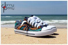 Baskets stylées en wax orange et turquoise par Jenny Patsy pour Afrikrea. https://www.afrikrea.com/article/baskets-en-wax-summer-baskets-bleu-pour-elle-coton/K8EEEUS?utm_content=buffer9b126&utm_medium=social&utm_source=pinterest.com&utm_campaign=buffer