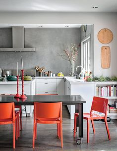 Kitchen - neutral walls, cupboards + floors with pops of accent color  [The San Francisco Envy Chain - NYTimes.com]