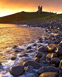 Dunstanburgh Castle at Dawn, Northumberland, UK built in 1313 by Earl Thomas of Lancaster. cousin of Edward II of England