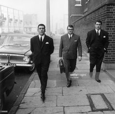 Notorious East End gangsters Ronnie (right) and Reggie (left) Kray, on their way to the Thames Street court in London.