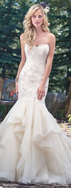 Understated drama is found in this fit and flare wedding dress with a stunning fitted lace bodice, accented with Swarovski crystals, and voluminous tiers of tulle and Chic organza layered throughout the skirt. Finished with sweetheart neckline and inner corset and covered buttons over zipper closure. Beaded lace keyhole coverlet sold separately.